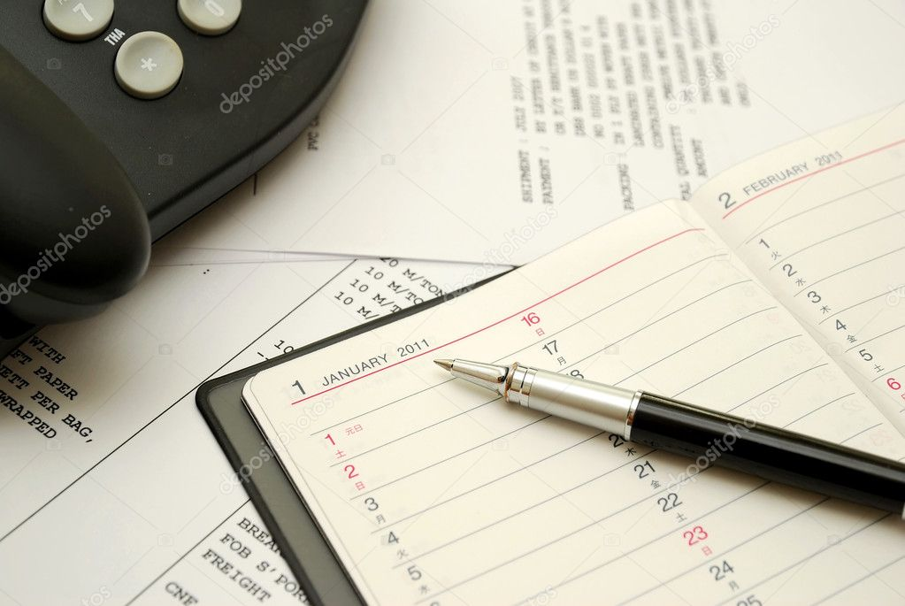 Black pen on planner with business documents in background, signifying concepts such as office and business, planning for the new year, financial budget and wor — Stock Photo #5842863