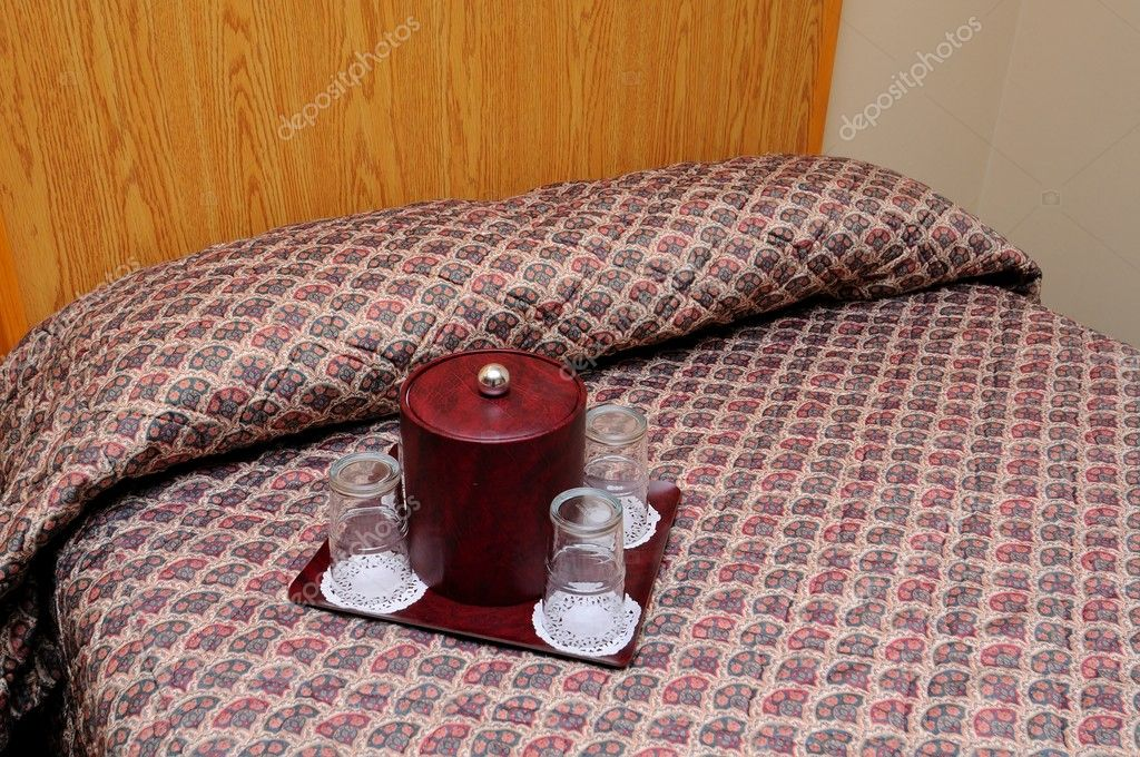 Comfortable bedroom with clean glasses for a relaxing drink.  Stock Photo #5845444