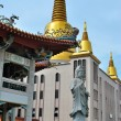 Buddhist statue and pagoda — Stock Photo