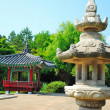 Stone lamp with quaint oriental pavillion — Stock Photo