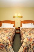 Twin hotel beds — Stock Photo