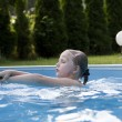 Girl smilimg in pool — Stock Photo #6125346