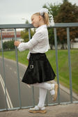 Schoolgirl standing near handhold — Stock Photo