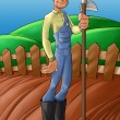 Farmer in a planted soil - Stock Photo