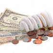 Energy saving light bulb and money — Stock Photo