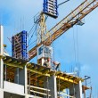 Crane and highrise construction site — Stockfoto