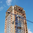 Crane and highrise construction site — Stock Photo #5952831