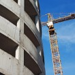 Crane and highrise garage construction site — Foto Stock