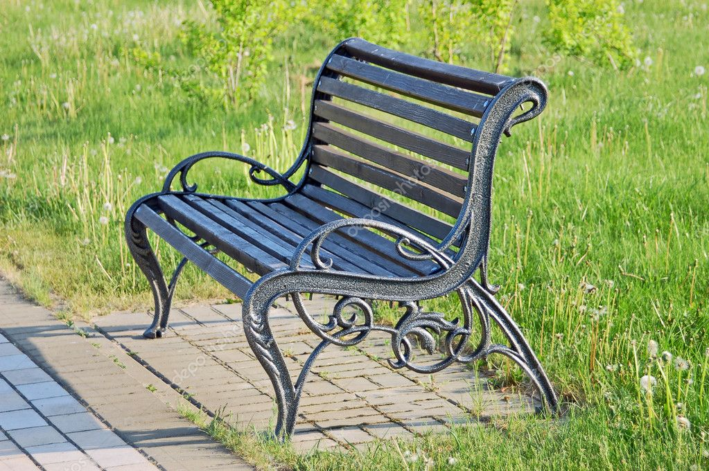 Bench in the park with grass on background — Stock Photo #6045888