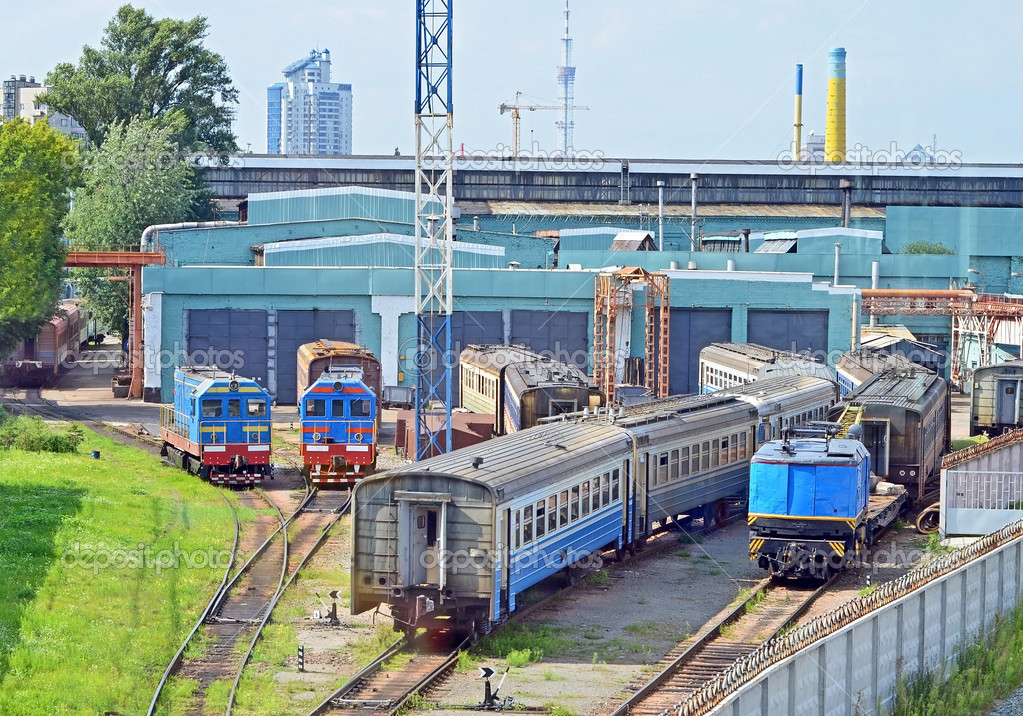 Old locomotive and train wagon in depot — Stock Photo #6443549