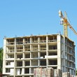 Stock Photo: Crane and highrise construction site