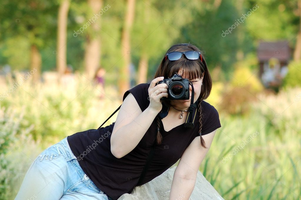 Yong woman photographer with camera in park  Stock Photo #6655253