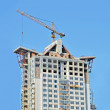 crane and highrise construction site — Stock Photo #6680636