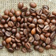 Stock Photo: Coffee beans on burlap