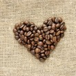 Stock Photo: Heart with coffee beans on burlap