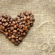 Stock Photo: Coffee beans in shape of heart on burlap