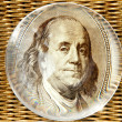Stock Photo: Franklin portrait looking out of magnifying glass on gol