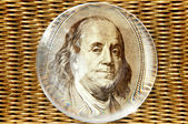 Franklin portrait looking out of the magnifying glass on the gol — Stock Photo
