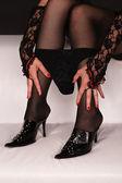 Erotic feet with underwear on a white sofa — Stock Photo