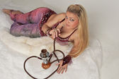 The woman smoking hookah — Stock Photo