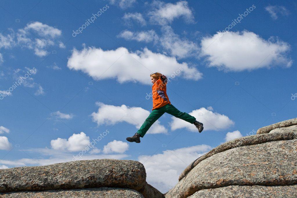 Women jump through the gap stock photo rumo 6631204 for Jump the gap