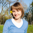 Smiling girl sitting in the park — Stock Photo #5888427