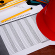 Helmet, level, pencil, briefs on a table — Stock Photo