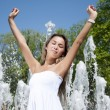 Young woman lifts upwards hands — Stock Photo