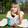 Young woman reading book in park — Stock Photo #5888664