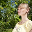 Portrait of the woman in park — Stock Photo #5888673