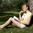 Young woman reading book in park — Stock Photo #5888674