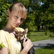 Portrait of the girl and small dog — Stock Photo
