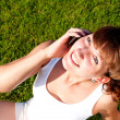 Стоковое фото: Portrait of young woman talking on cell