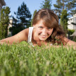 Стоковое фото: Beautiful young woman smiling in a field
