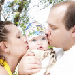 Parent kissing their baby boy — Stockfoto