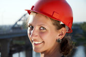 Young architect-woman wearing a protective helmet — Stock Photo