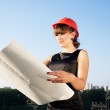 Business woman considers construction plans — Stock Photo