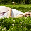 图库照片: Beautiful pregnant womrelaxing on grass