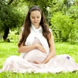 Beautiful pregnant womrelaxing in park — Stock Photo #6176322
