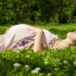 Beautiful pregnant womrelaxing in park — Stock Photo #6226885