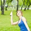 Stock Photo: Beautiful Young Woman with Badminton racket