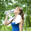 Young woman drinking water after exercise — Stock Photo #6619047