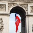 Arc de triomphe with french flag - Stock Photo