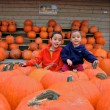 Royalty-Free Stock Photo: Children in Pumpkins
