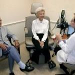 Doctor and elderly couple — Stock Photo