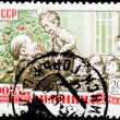 Stock Photo: Postal stamp. V.I. Lenin and child, 1960