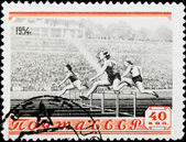 Postal stamp. Hurdle race, 1954 — Stock Photo