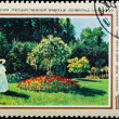 Postal stamp. The lady in a garden, 1867. — Stock Photo