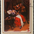 Stock Photo: Postal stamp. The patient and the doctor, 1660.