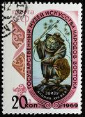 Postal stamp. Man fishing rod, 1969 — Stock Photo